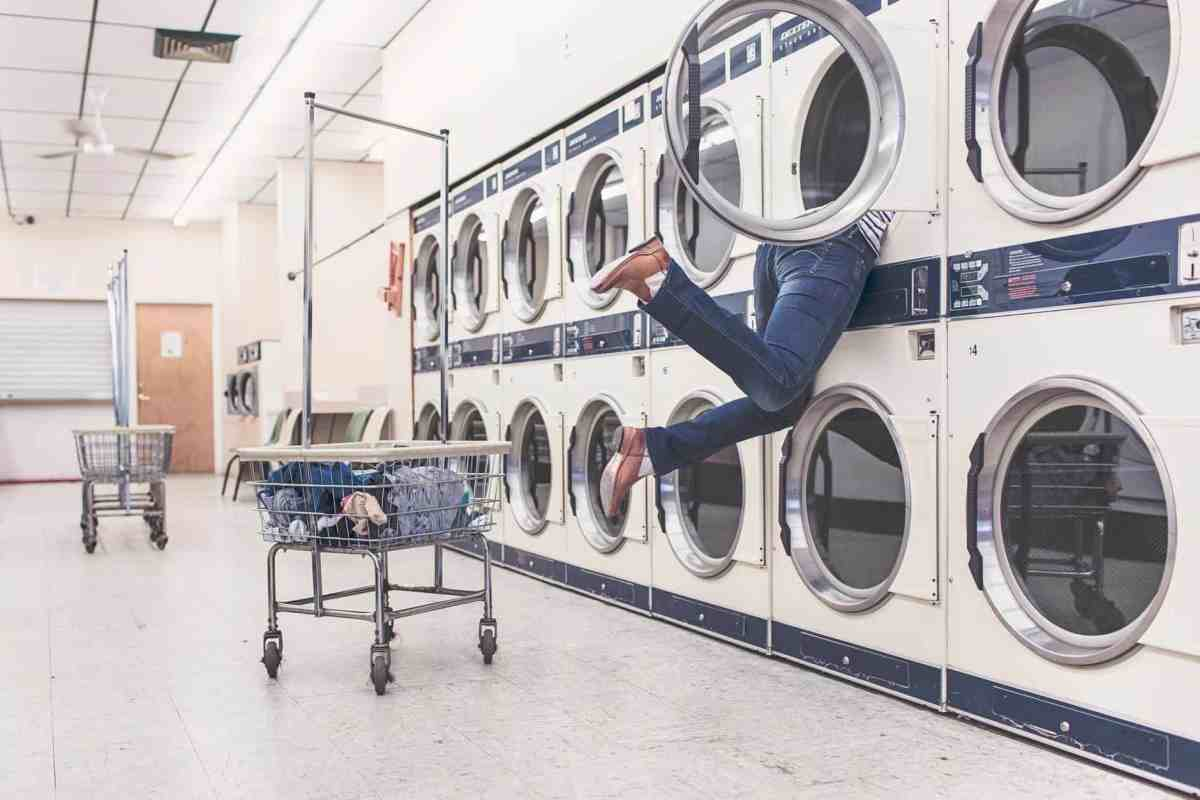 a woman taking responsibility by climbing inside a washing machine. A metaphor for digging deep within to find your truest desires