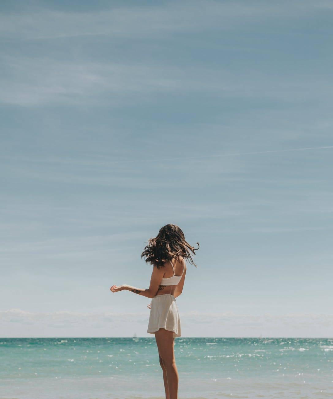 young woman enjoying summer day on beach
