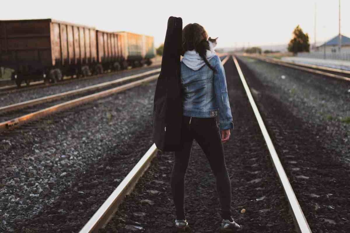 woman standing on train rail