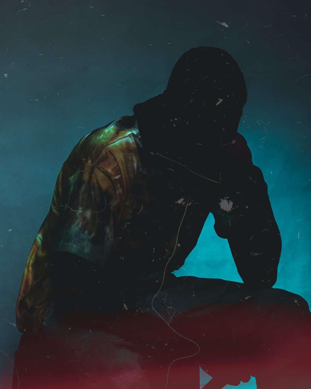 faceless man in black sack on head in dark room
