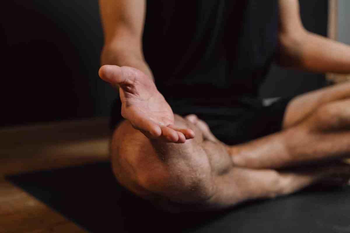 man practicing meditation on sports mat Welcoming Abundance