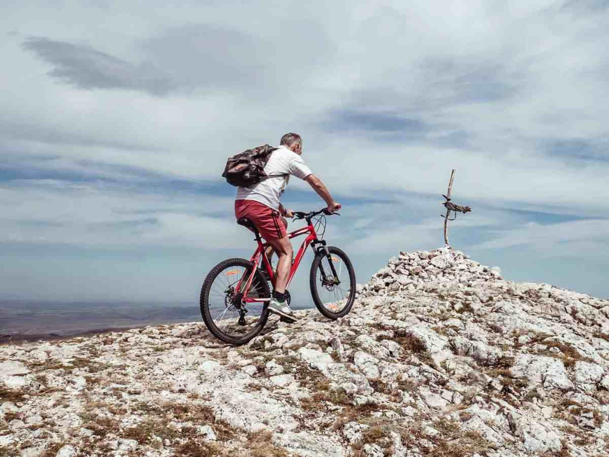 man riding bicycle on off road - why you should stop meditating
