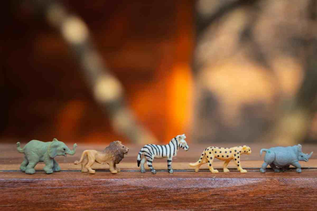 plastic animal toys on wooden surface - alignment can shape your future