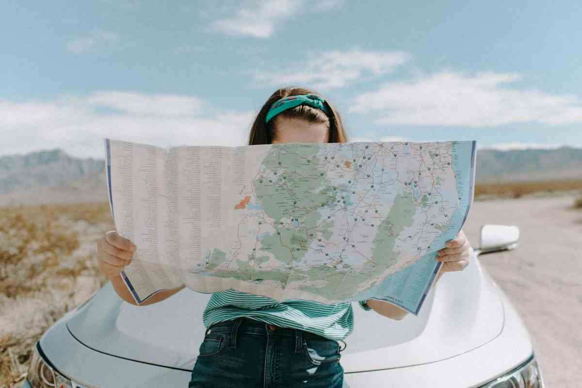 woman looking at the map - definition of manifestation