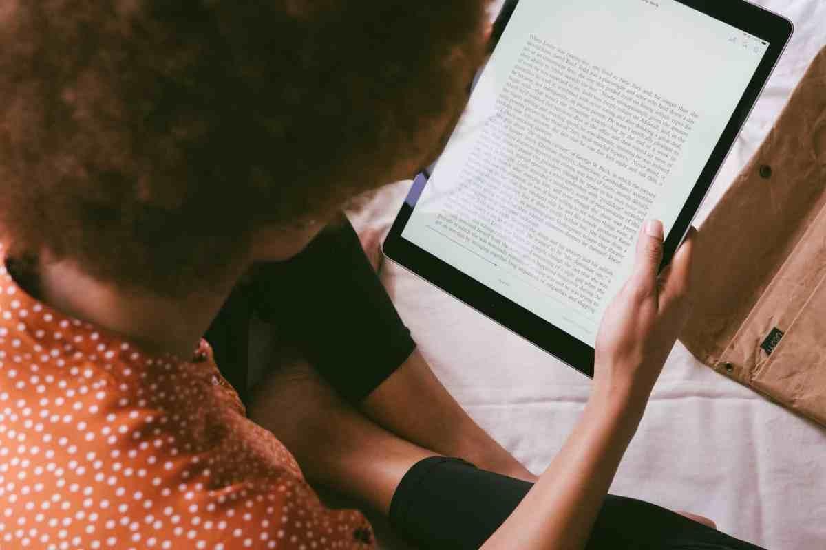 high angle photo of person reading an e book