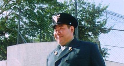 Le chef des gardiens de la prison (Fan Mei Sheng) dans Story of Ricky