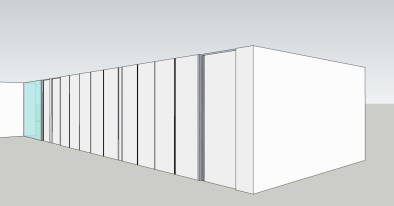 Gesloten dressing op maat ontwerp van een lange kastenwand.