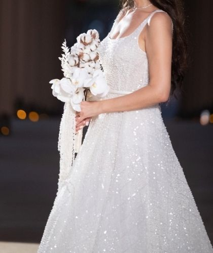 """img src="""" Buy Sell Wedding Dress Online Dubai UAE White Sandy Nour A-Line Dress with Square Neckline and Open Back. Fully beaded with pearls, Size M"""" alt="""" Buy Sell Wedding Dress Online Dubai UAE White Sandy Nour A-Line Dress with Square Neckline and Open Back. Fully beaded with pearls, Size M"""">"""