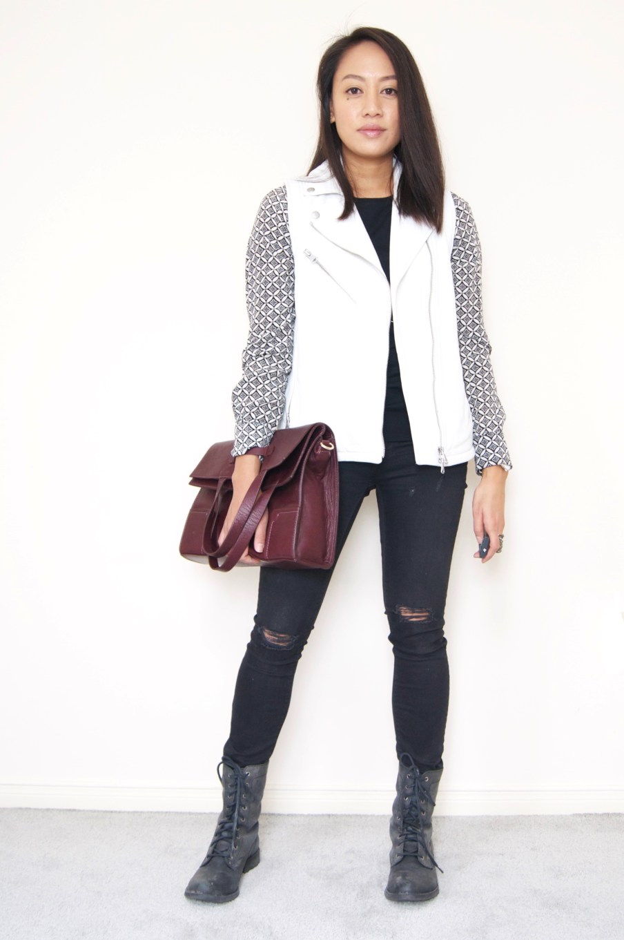 DRESSED ACCORDINGLY // white leather vest + ripped denim + combat boots