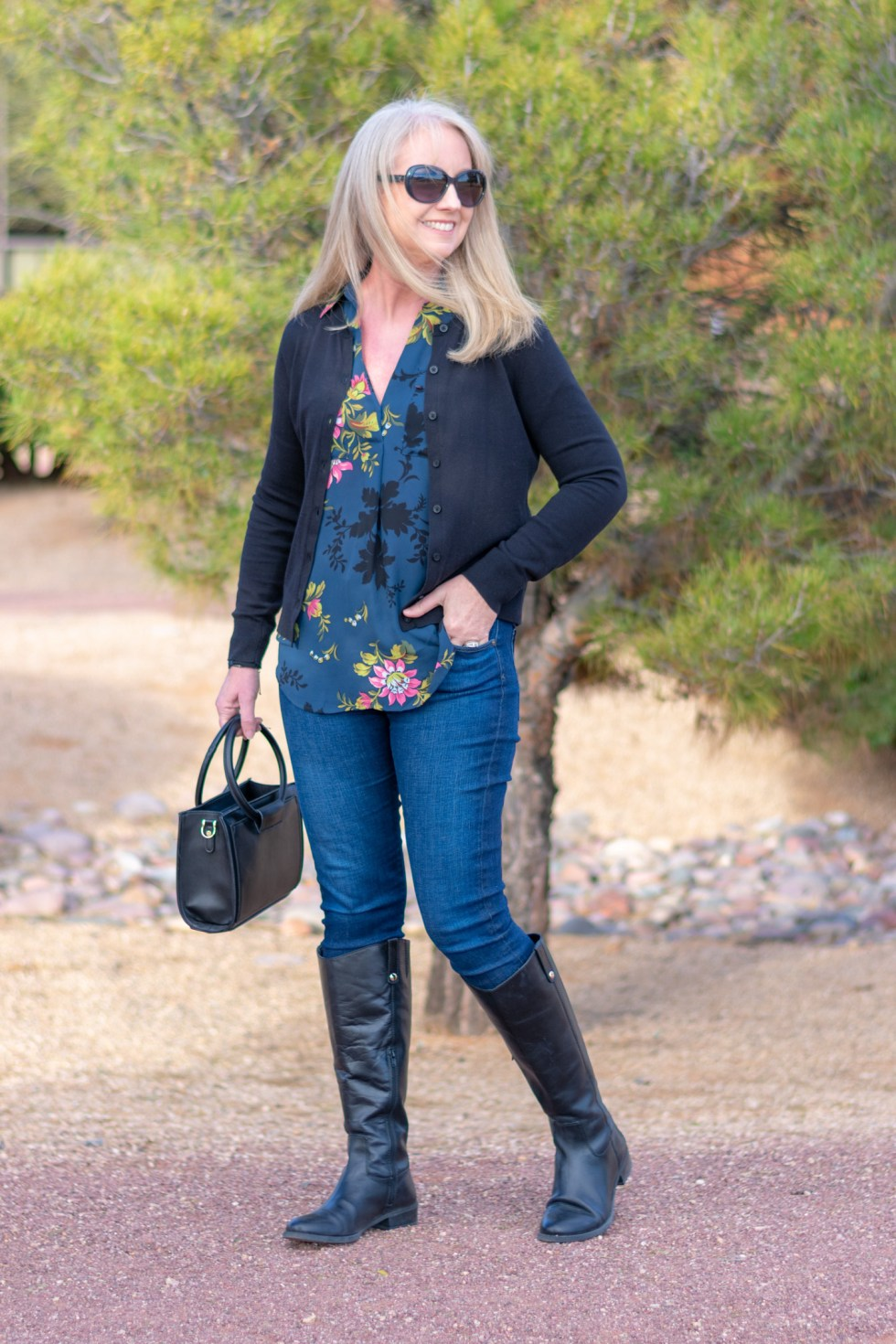 black riding boots with blue jeans