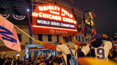 wrigley-field-marquee-chicago-cubs-fans-world-series-win-696x385