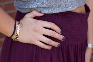 Rose gold accessories add elegance to her casual look.