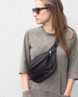 Black Leather Fanny Pack By DAPHNY RAES. Handmade Out Of Soft Italian Leather In Amsterdam. Perfect Companion For A Sping Stroll In The Park Or A Shopping Trip! Get Yours Now! Or Save It For Later! #fannypack #spring #leather #black