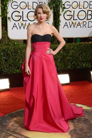Wearing a gown from the Carolina Herrera pre autumn-winter 2014 collection to the Golden Globe Awards.