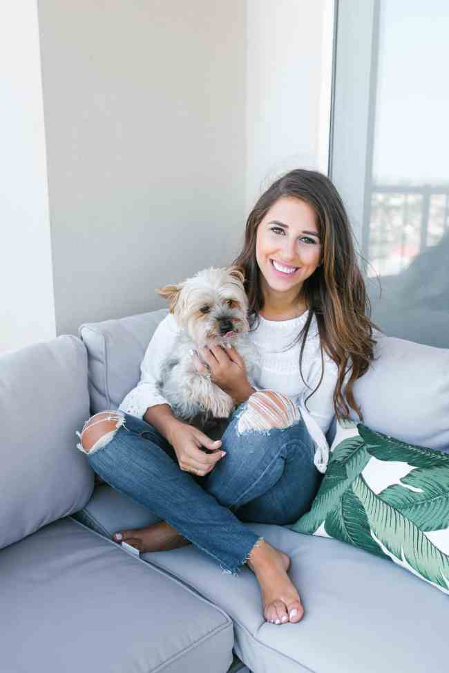 Dress Up Buttercup, Dede Raad, Houston Blogger, Fashion blogger, Patio Furniture,Gray outdoor seating, palm leaf pillow, ripped jeans, cute puppy