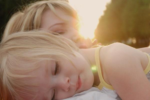 a child resting on a shoulder