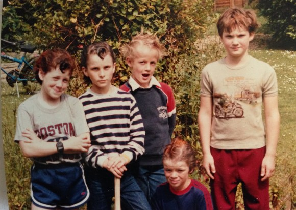 Five kids in a garden with punk styled hair.
