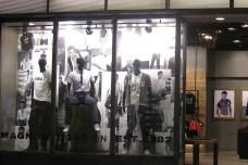 shop window display VMD, white collection in Senzhen shop | British Fashion Retail Brand – Magnum London :: graphical visual merchandising
