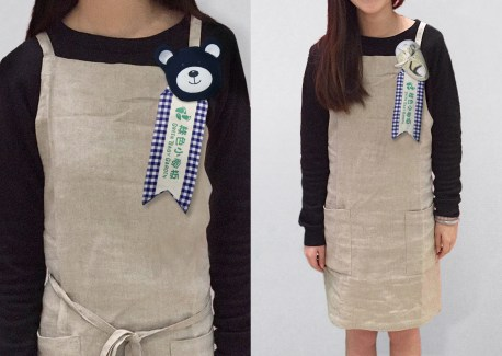 Green Baby Garden :: upcycling uniform apron with identity brooch