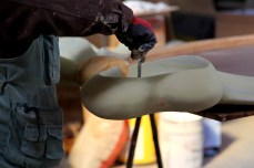 worker smoothing paints of furniture   Leading Retail Renovation Brand – HTHY Group :: Photography of Factory for brand book