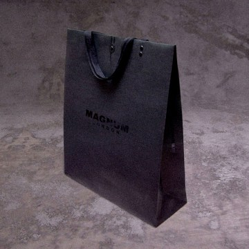 all logo black paper shopping bag smallest size, fastening opening, reinforced carrying lifter | British Fashion Retail Brand – Magnum London : : holistic, retail and product packaging