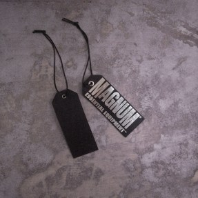 retail hangtag product tag metallic foil on black cardboard   British Tactical Apparel Wholesale Brand – Magnum Essential Equipment :: branding