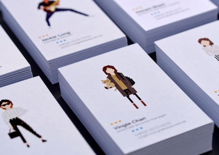 A leading Asian Digital Marketing Agency Brand based in Hong Kong and office in South Korea :: Identity Revamp and New Business Card Design :: business card, name card, 2 x 4, 8 decks, dynamic branding, personalisation pixelated figures of every individuals, black table top, focusing on VC young girl holding a cat, anglar view