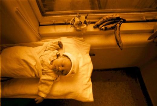 Boy with banana, February 6, 2000.