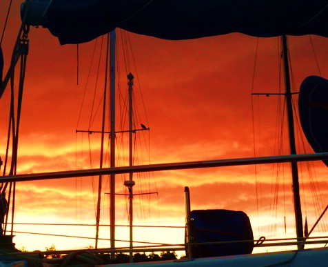Putting the coffee on, a sunrise view through the galley portlight