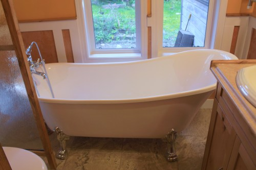 To this... Heated tile floor, wainscoting, acrylic clawfoot tub, recycled shower glass becomes toilet divider. Well I'm chuffed about it!
