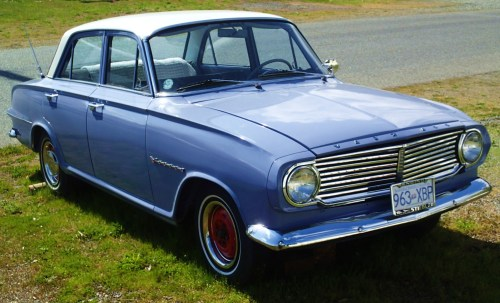 On a back street in Ladysmith. a late 50s Vauxhall Victor Super One of my first cars was one of these. God, it's ugly!