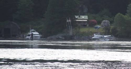 Now THAT'S a leaf blower! A Hughs 500 helicopter and a Turbo Beaver at a private home on Stuart Island, Yuculta Rapids