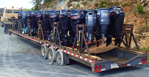 The kickers are spawning! A load of lease-return outboard motors heads south at the end of the sport fishing season