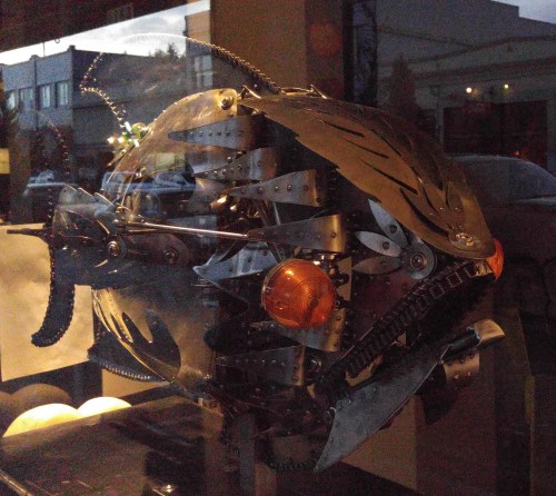 Another art gallery window. This metal sculpture is about four feet long. The tail, the jaws, the fins and the eyes move. They're cleverly recycled motorcycle lights