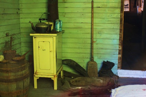 Through a window, a scene from a woodcutter's cabin just as it was left.
