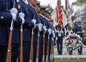 The Coast Guard Honor Guard stands in formation before the beginning of the Coast Guard's Veteran's Day wreathlaying ceremony at Arlington National Cemetary.  USCG photo by PA1 Adam Eggers