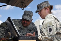 Sgt. Stephanie L. Peavy of Machesney Park, Ill., and Spec. John G. Matsoukas of Chicago, both members of the 244th Army Liaison Team based in Chicago, tests the capability of an operating system being tested by the U.S. military for possible fielding of new equipment during an annual training exercise called Coalition Warrior Interoperability Demonstration. CWID 2011 spans five U.S. locations and more than 20 coalition partners worldwide. The participating technologies were approved based on how well they address capability gaps and evaluates how well they assists in the exchange of information between coalition partners, military services, government agencies, first responders and U.S. combatant commanders.