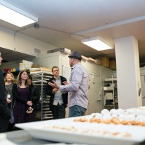 Mark Estee gives a tour of the new Reno Provisions downstairs kitchen during its grand opening Dec. 2. Pastries are set out for samples during the event. Photo by Mike Higdon