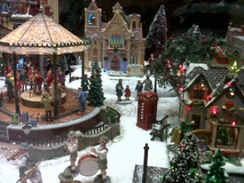 i know i am too big to fit inside these plastic molded hallmark christmas village squares but i swear to you that since i was a little kid i have dreamt of - Hallmark Christmas Village
