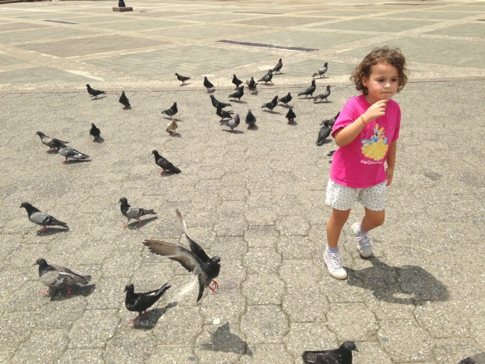 Feeding pigeons in the Colonial Zone