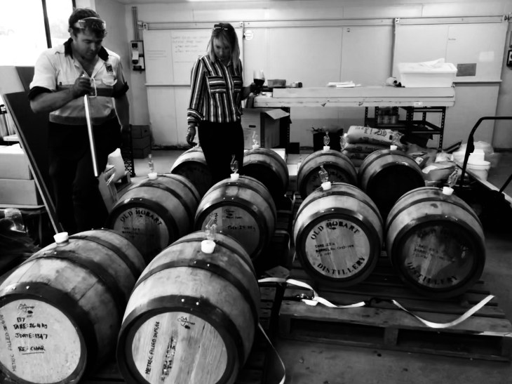 The Bruny Island Beer team inspecting beers aged in barrels sourced from Overeem Whisky in Hobart