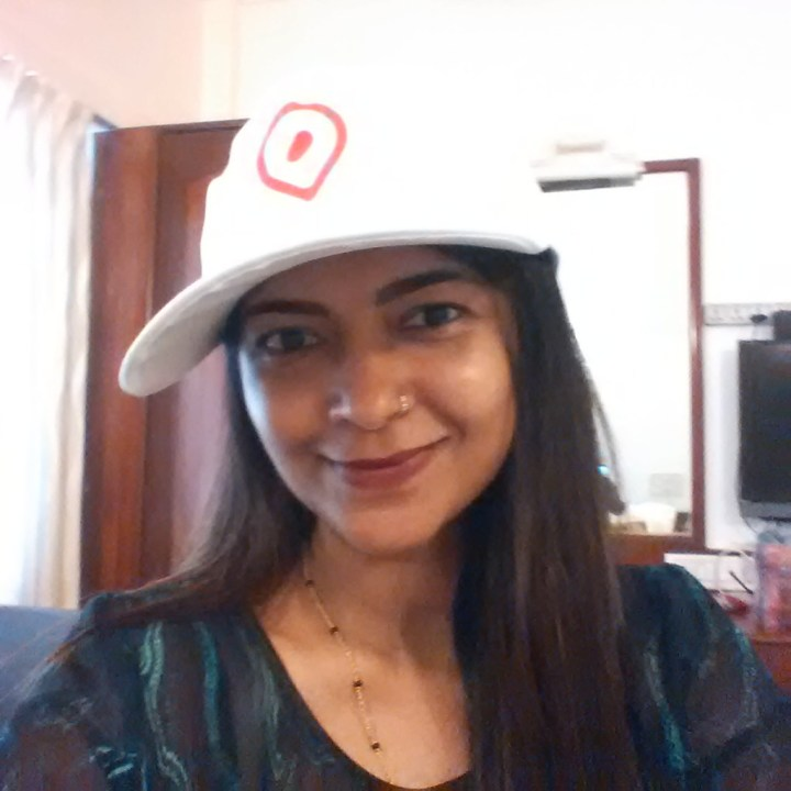Posing with the OYO cap
