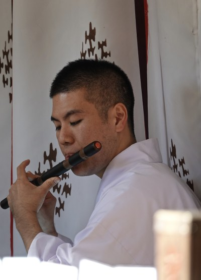 a priest playing flute