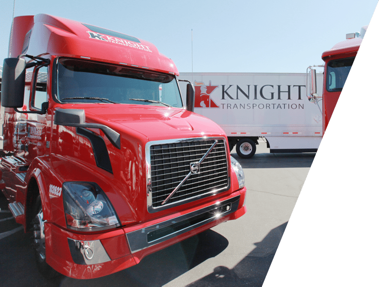 Knight Transportation cabs in front of company trailer