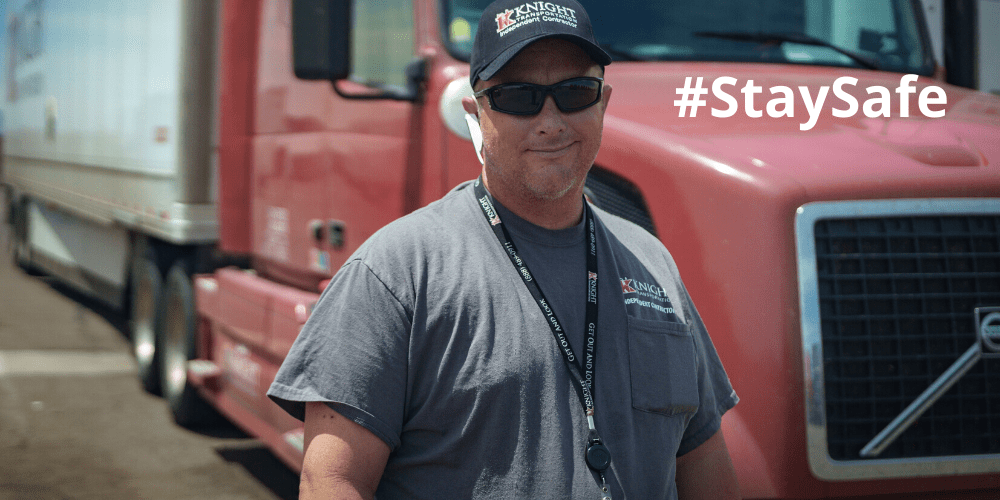 Drive standing in front of a Knight Transportation truck, #staysafe showing, Top 10 COVID-19 Safety Tips post cover image