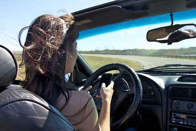 Teen girl reading text - Courtesy of NHTSA