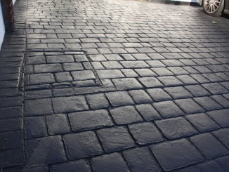 pattern imprinted concrete with printing mistake deep joint cobble charcoal
