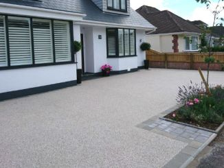 house with resin bound driveway with block paving border and flowerbed