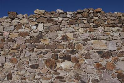 Stone wall, missing its top.