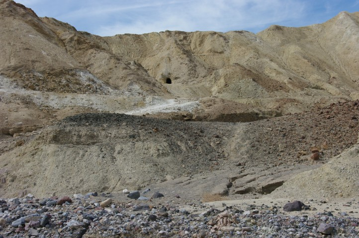 A mine shaft high on the cliff wall.
